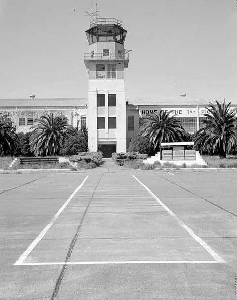 CONTROL TOWER AND RED CARPET, PAINTED ON CONCRETE APRON.