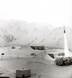 Looking southeast at Site Summit's missile launch site during firing of a missile, 1960